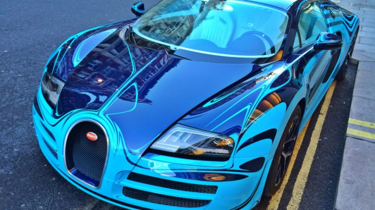 this one of a kind uniquely painted bugatti veyron turn heads on the streets. Black Bedroom Furniture Sets. Home Design Ideas