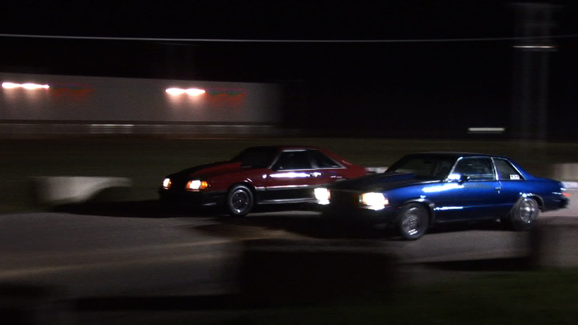 Street Race Is A Close Match As The Cars Come Up To The Finish Line ...